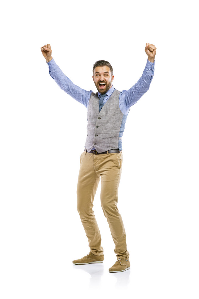 Studio shot of modern hipster businessman celebrating his business success, isolated on white background