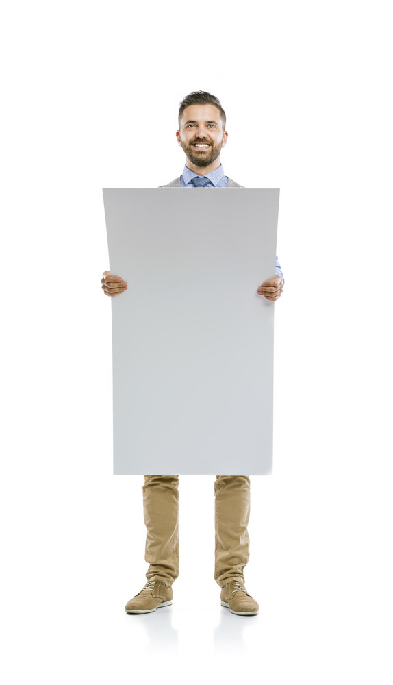 Studio shot of modern hipster businessman holding blank advertisement, isolated on white background