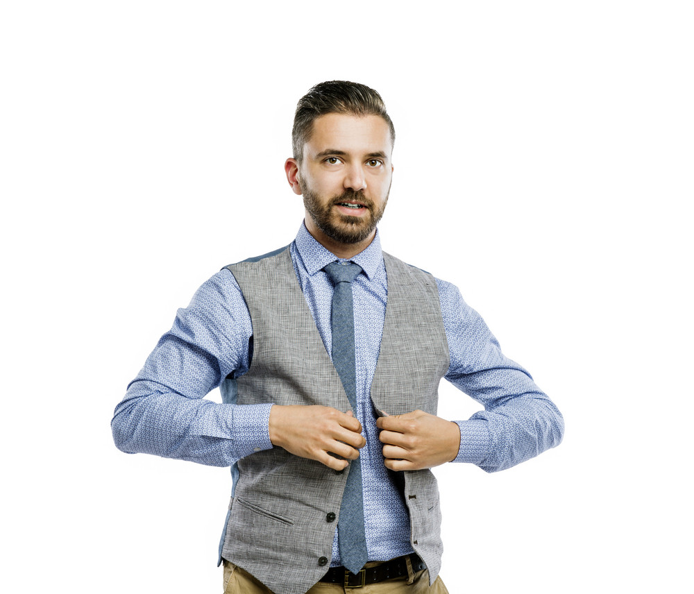 Studio shot of modern hipster businessman, isolated on white background