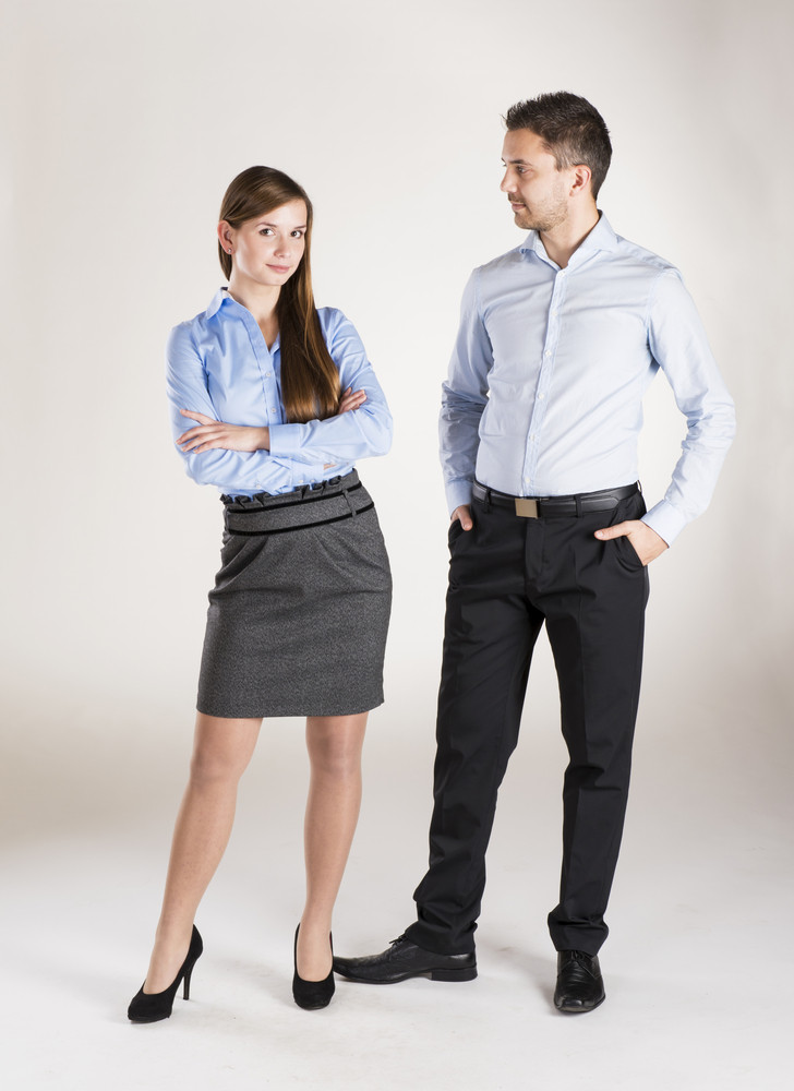 Successful business couple is standing in studio