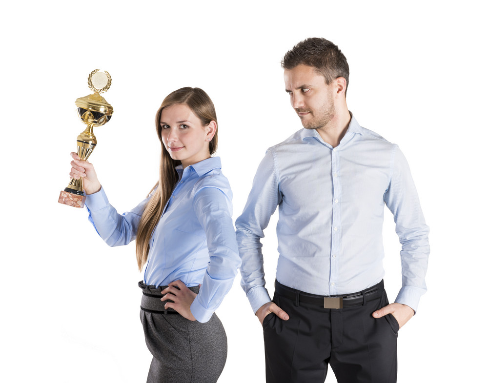 Successful business man and woman are celebrating on isolated white background