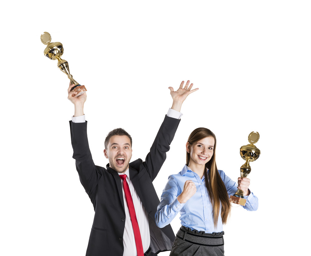 Successful business man and woman are celebrating on isolated white background.