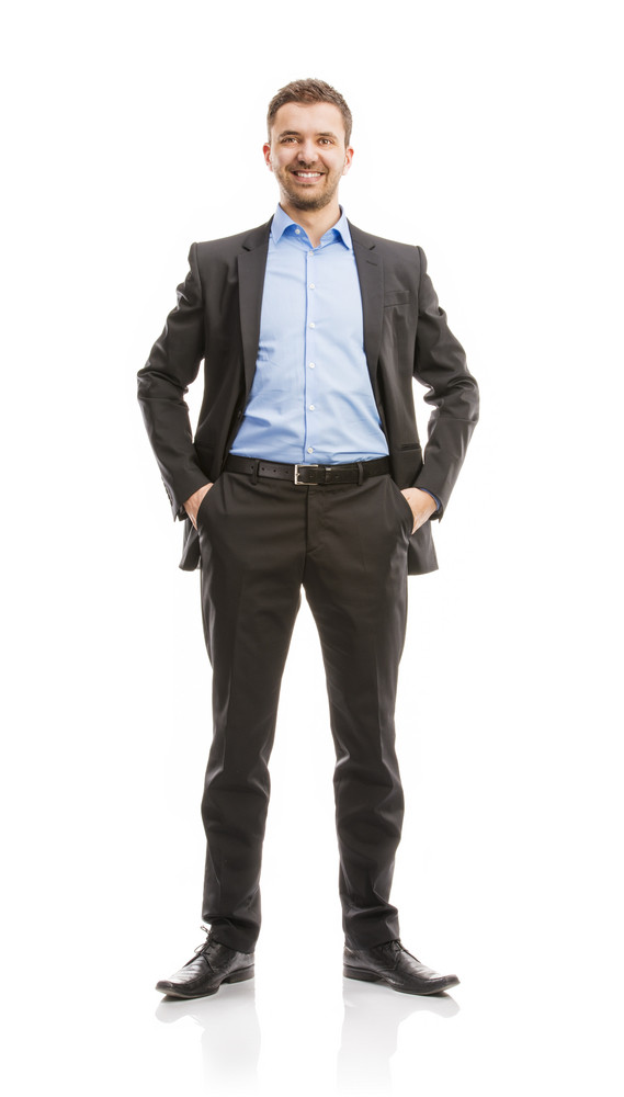 Successful business man in suit is posing in studio isolated over white background. Full body portraits.