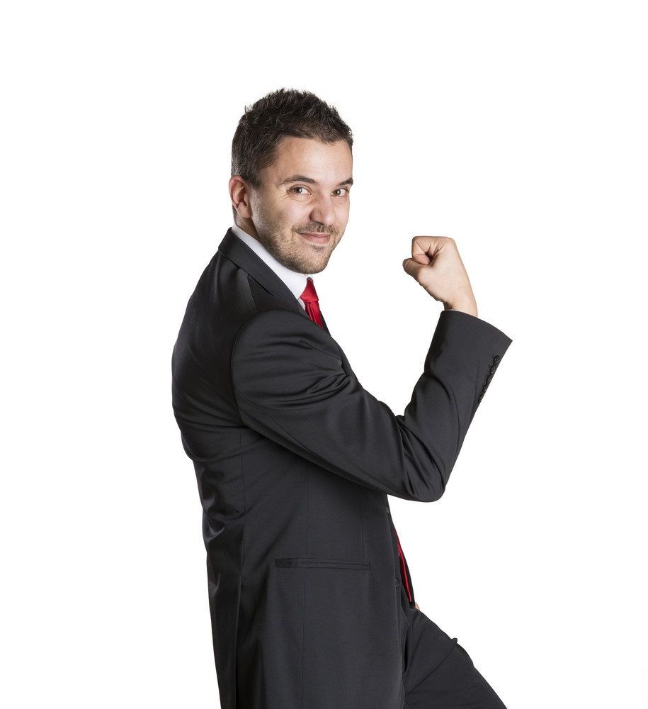 Successful business man is celebrating on isolated white background