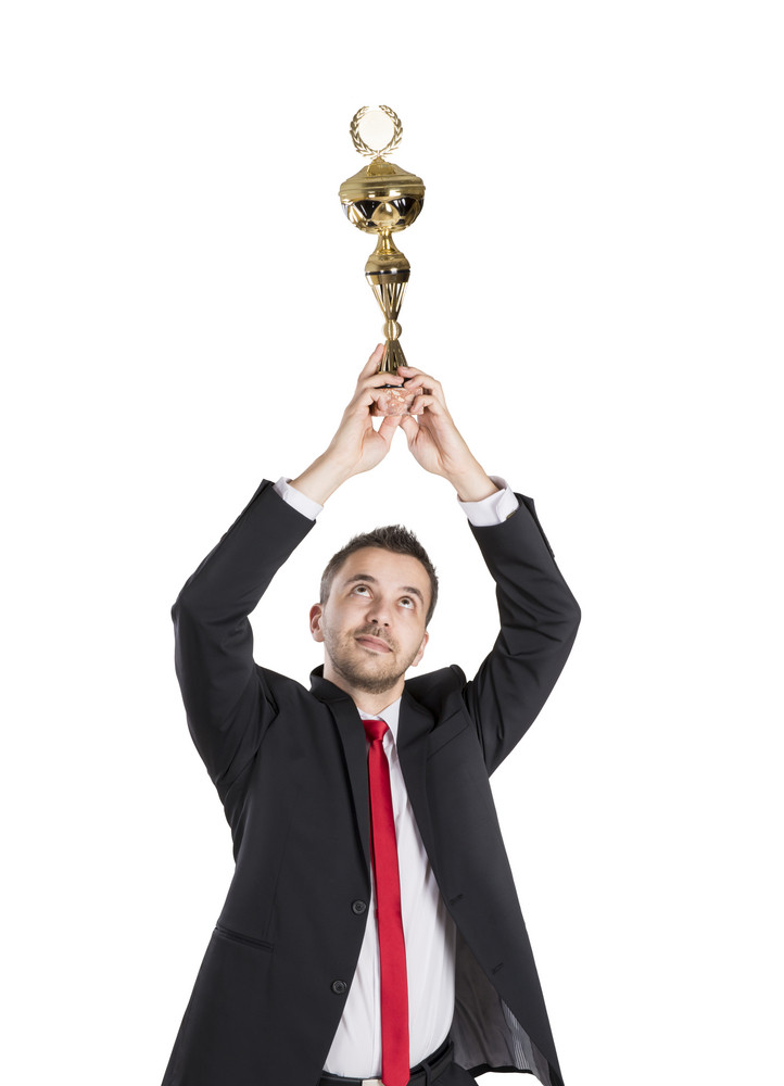 Successful business man is celebrating success on isolated white background