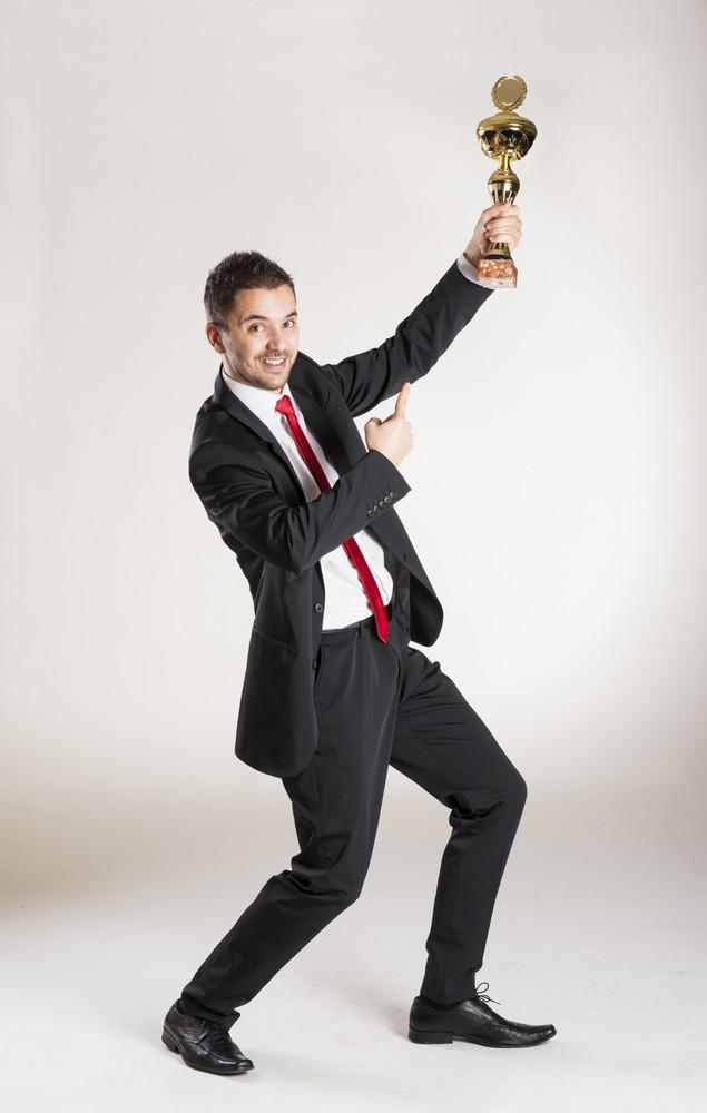 Successful business man is posing in studio