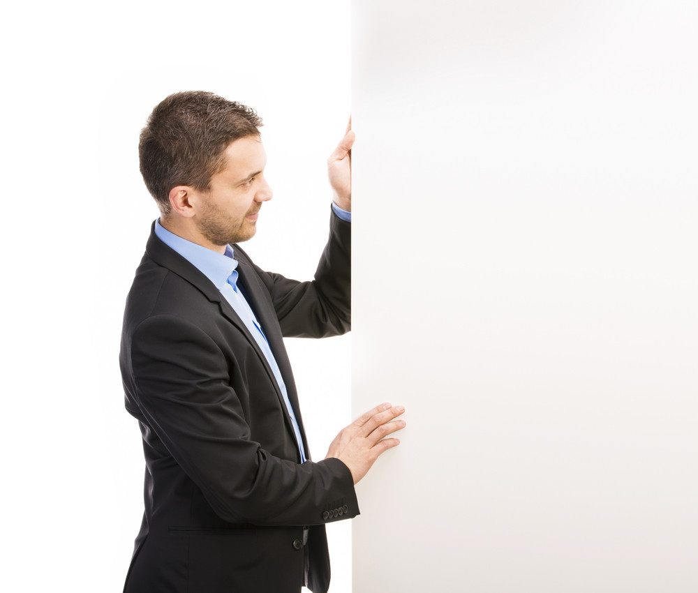 Successful business man is posing with blank copy space. Manager is isolated on white background.
