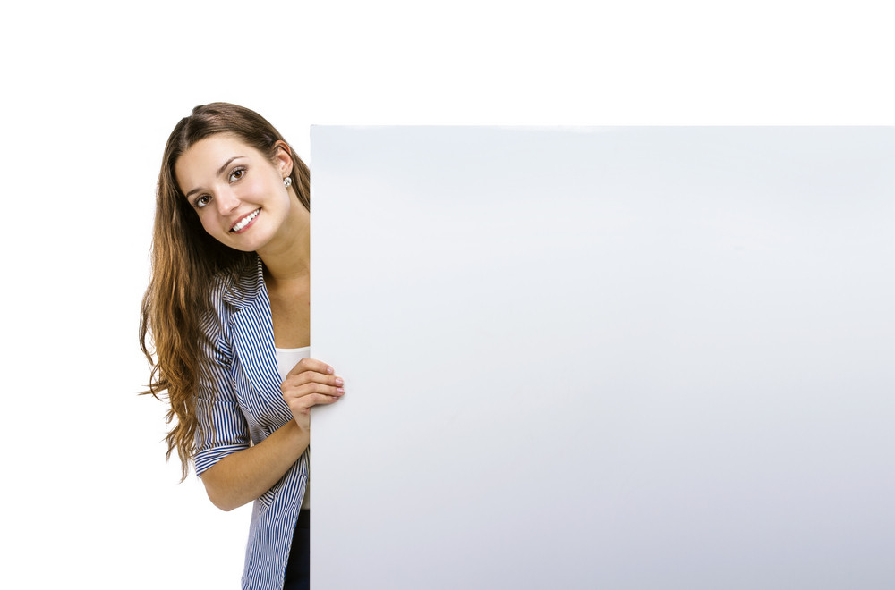 successful business woman is standing and holding blank banner