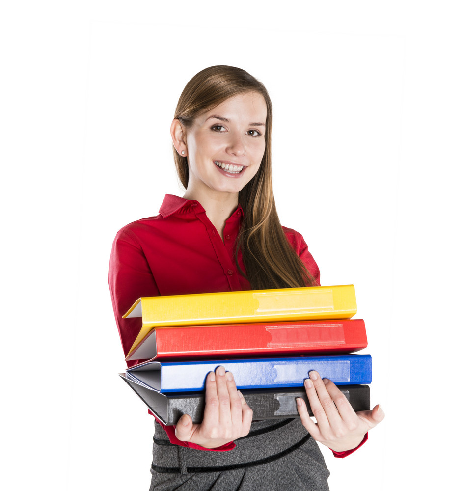 Successful business woman is standing with file folder on isolated background