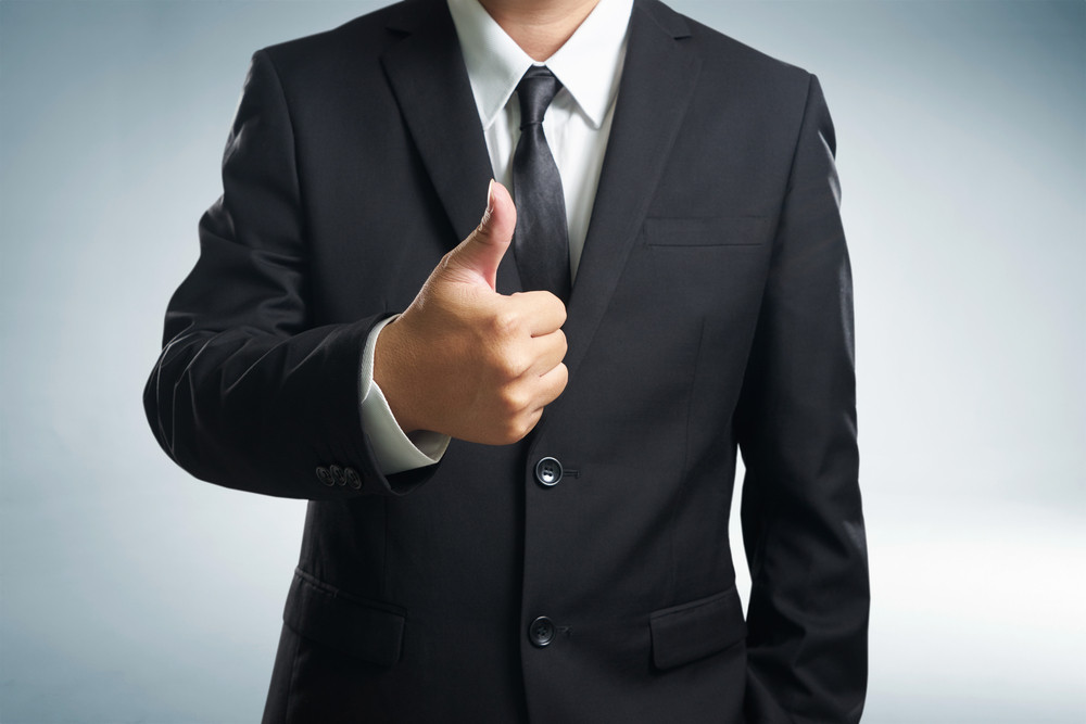 Successful businessman gives thumb up  style. Likes and positive feel. Gesture good and agree , finger agreement