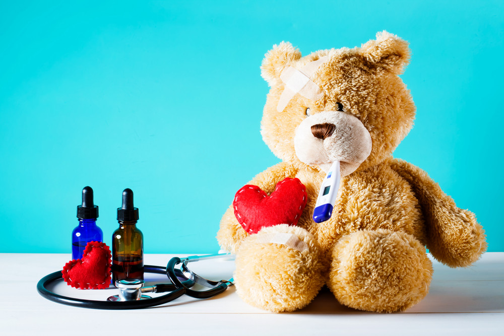 Teddy bear with a bandage on a blue background