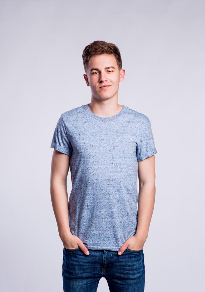 d796b357b4f Teenage boy in jeans and blue t-shirt