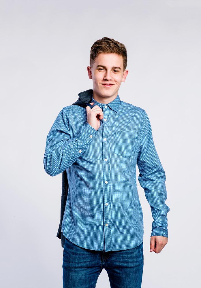 ec774bf74eb Teenage boy in jeans and denim shirt