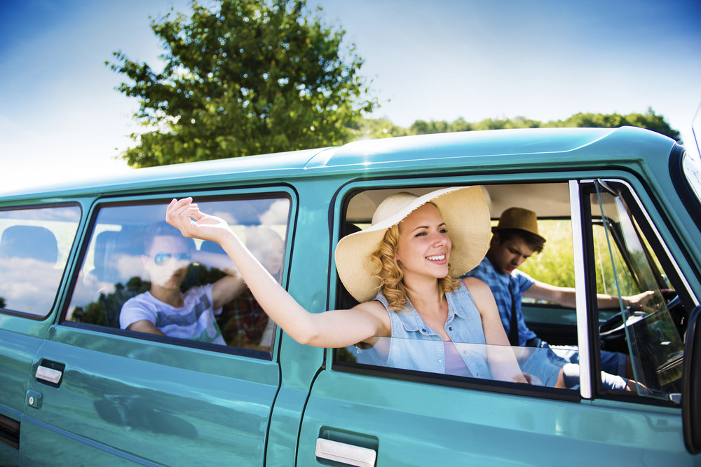 Teenage friends on a road trip on a summers day
