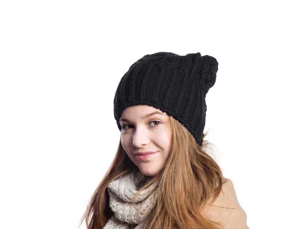 9e9aee893820 Teenage girl in brown winter coat and woolen scarf and hat