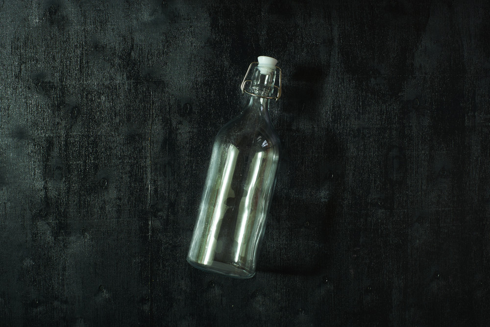 top view of glass water bottle  on wooden table