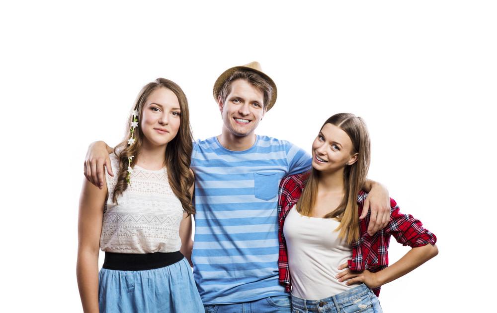 Trendy teenagers posing. Studio shot on white background