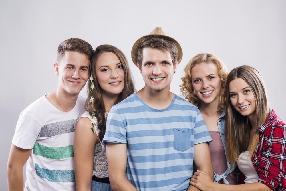 Trendy teenagers posing. Studio shot on white background.