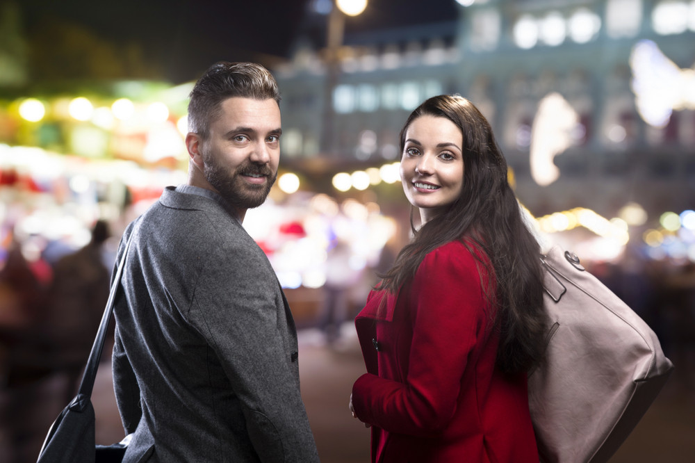 Trendy young hipster couple enjoying nightlife in the city
