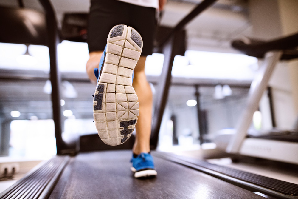 Unrecognizable Fitness Man In Gym Doing Cardio Workout Exercising On Treadmill Close Up Of Sole His Shoe Sport And Healthy Lifestyle Concept