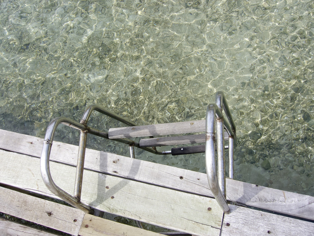 view of stairs and sea water