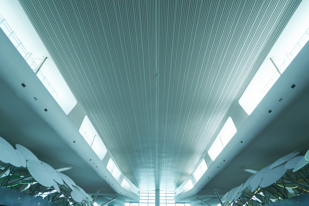 wide angled and perspective view to airport ceiling.