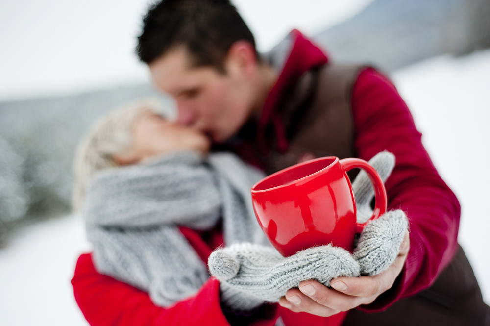 Woman and man are relaxing in winter snowy countryside