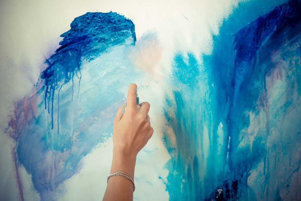 woman hand painting in her studio
