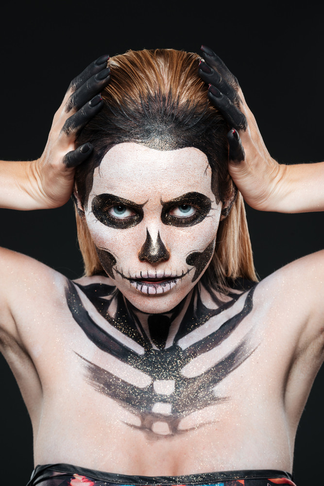 Halloween Make Up Skelet.Woman With Skeleton Halloween Makeup Over Black Background