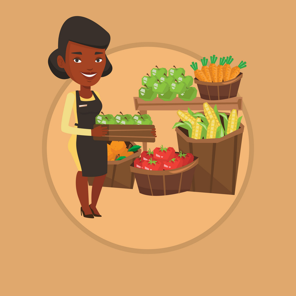 Worker of grocery store standing in front of section with vegetables and fruits. Worker of grocery store holding a box with apples. Vector flat design illustration in the circle isolated on background