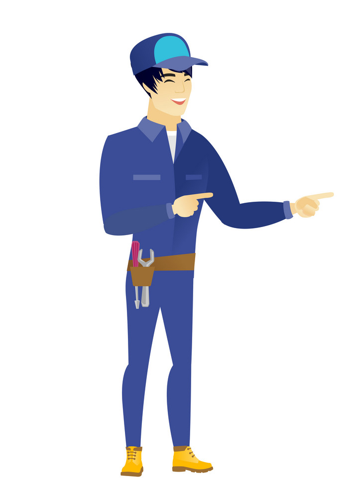 Young asian mechanic indicating with two fingers to the side. Full length of cheerful mechanic pointing with two fingers to the side. Vector flat design illustration isolated on white background.