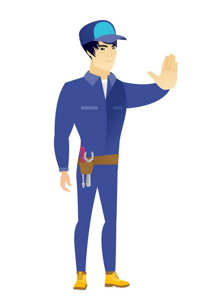 Young asian mechanic showing stop hand gesture. Full length of mechanic doing stop gesture. Serious mechanic with a stop gesture. Vector flat design illustration isolated on white background