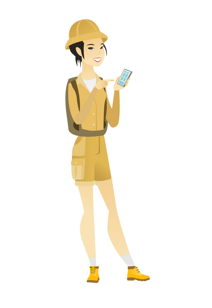 Young asian traveler holding mobile phone and pointing at it. Full length of traveler with mobile phone. Traveler using mobile phone. Vector flat design illustration isolated on white background.