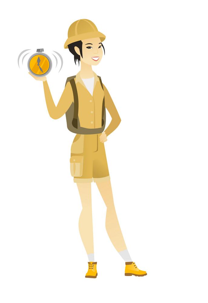 Young asian traveler showing ringing alarm clock. Full length of female traveler with alarm clock. Happy traveler holding alarm clock. Vector flat design illustration isolated on white background.