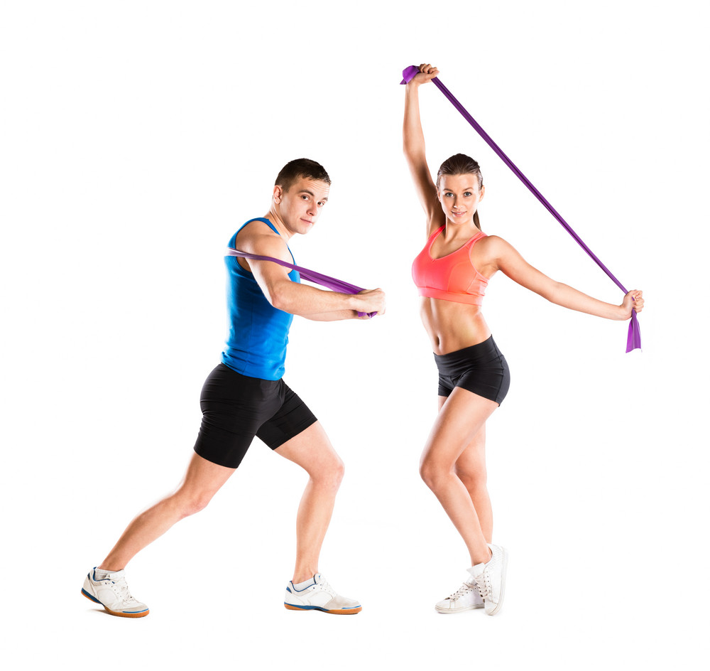 Young athlete doing exercises with a resistance band