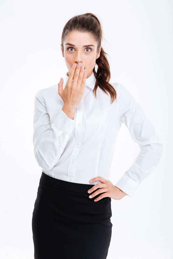 Young beautiful businesswoman covering her mouth with palm isolated on a white background