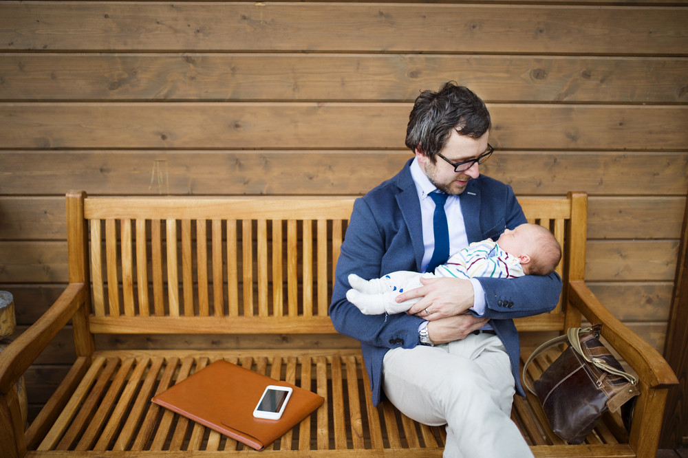 Marvelous Young Businessman With His Little Baby Daughter Sitting On Ocoug Best Dining Table And Chair Ideas Images Ocougorg
