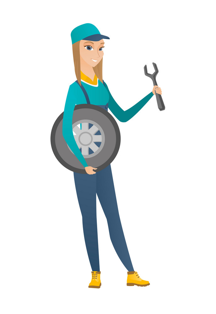 Young caucasian auto mechanic in uniform holding spanner and wheel. Full length of female smiling auto mechanic with tyre and spanner. Vector flat design illustration isolated on white background.