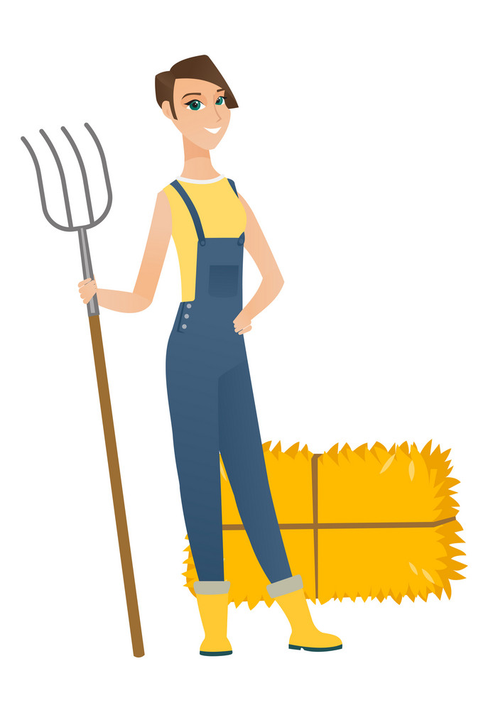Young caucasian farmer in overalls standing with a pitchfork on the background of hay bales. Full length of farmer holding a pitchfork. Vector flat design illustration isolated on white background.