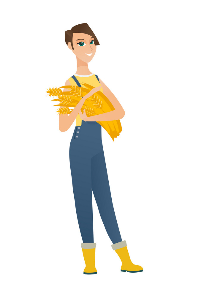 Young caucasian female farmer in overalls holding hay in hands. Full length of happy female farmer with hay in hands. Farmer carrying hay. Vector flat design illustration isolated on white background.