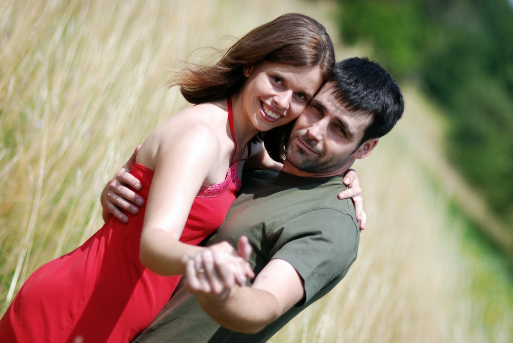 Young couple standing in the field.