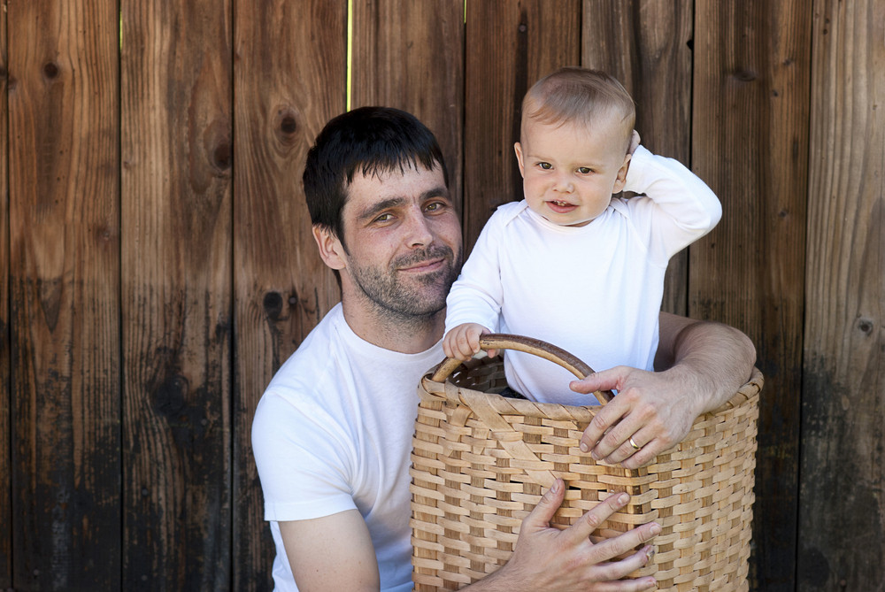Young father and son playing together portrait