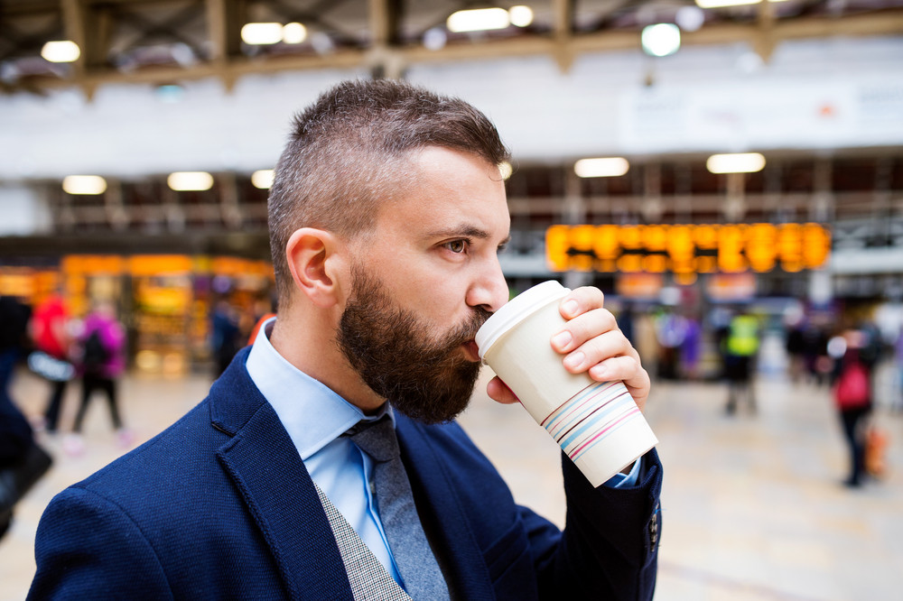 Young handsome businessman with cup of coffee