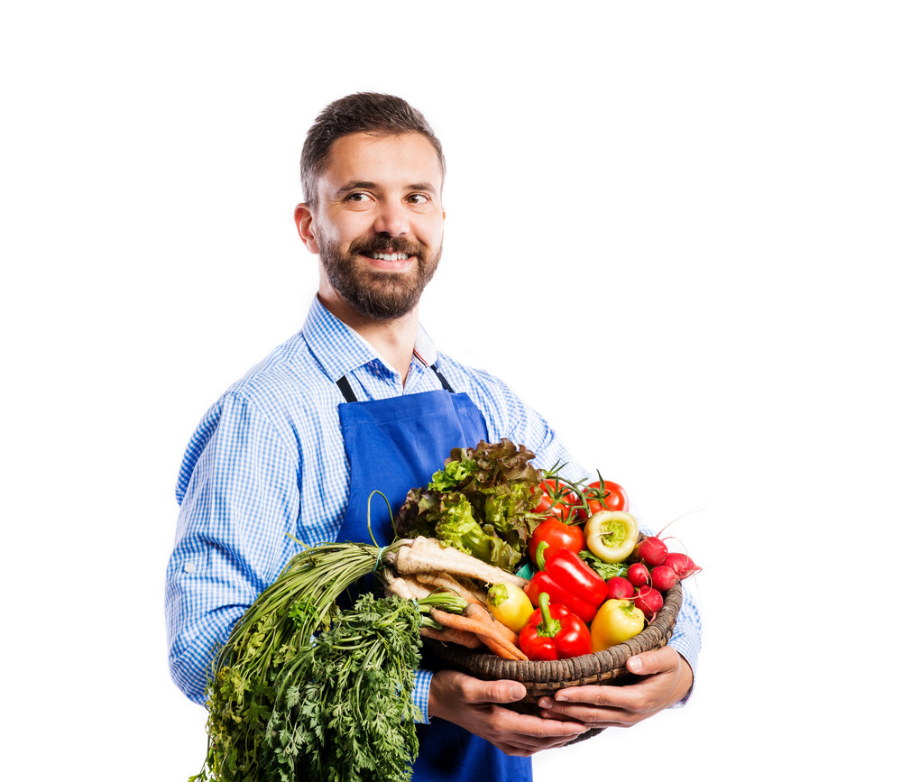 Young handsome gardener in blue apron. Studio shot on white background