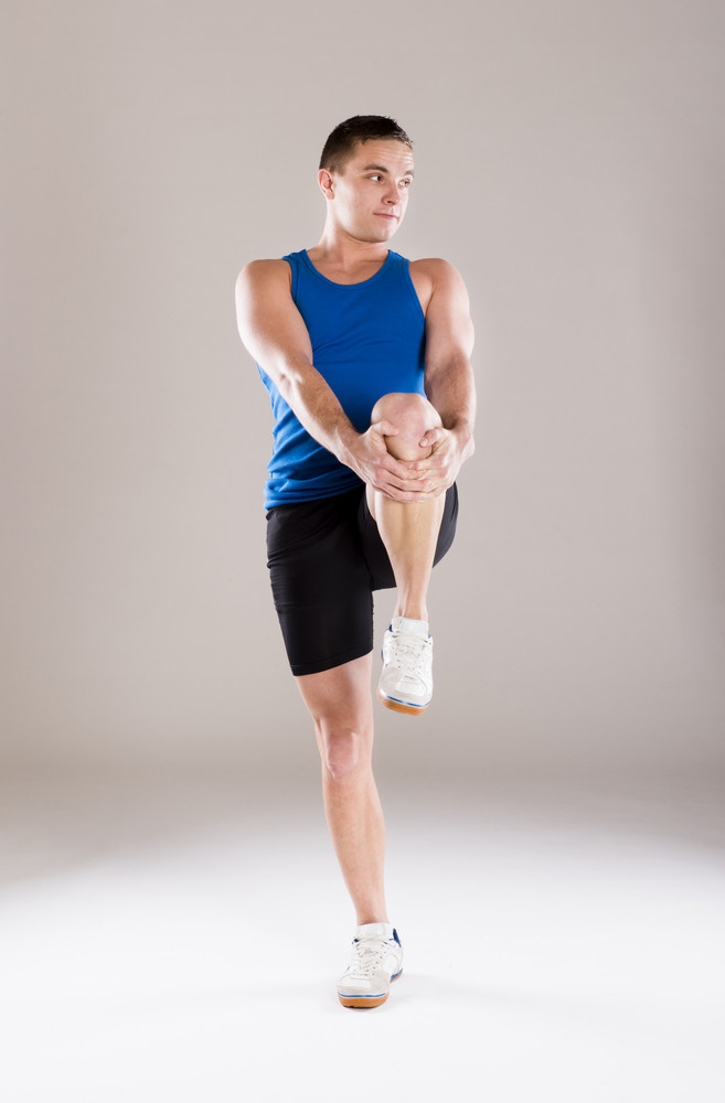 Young handsome man with perfect body in sport clothes.