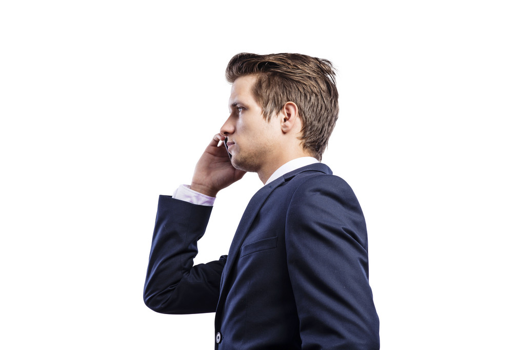 Young hipster businessman with smart phone. Isolated on white background.