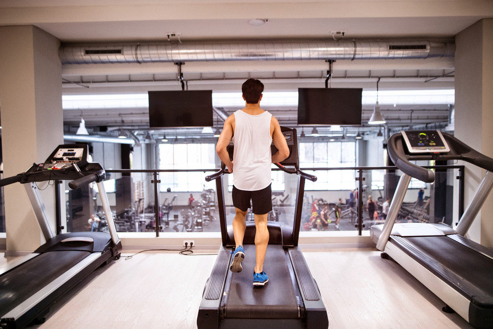 Young Hispanic Fitness Man In Sports Clothing Gym Doing Cardio Workout Exercising On Treadmill Sport And Healthy Lifestyle Concept Rear View