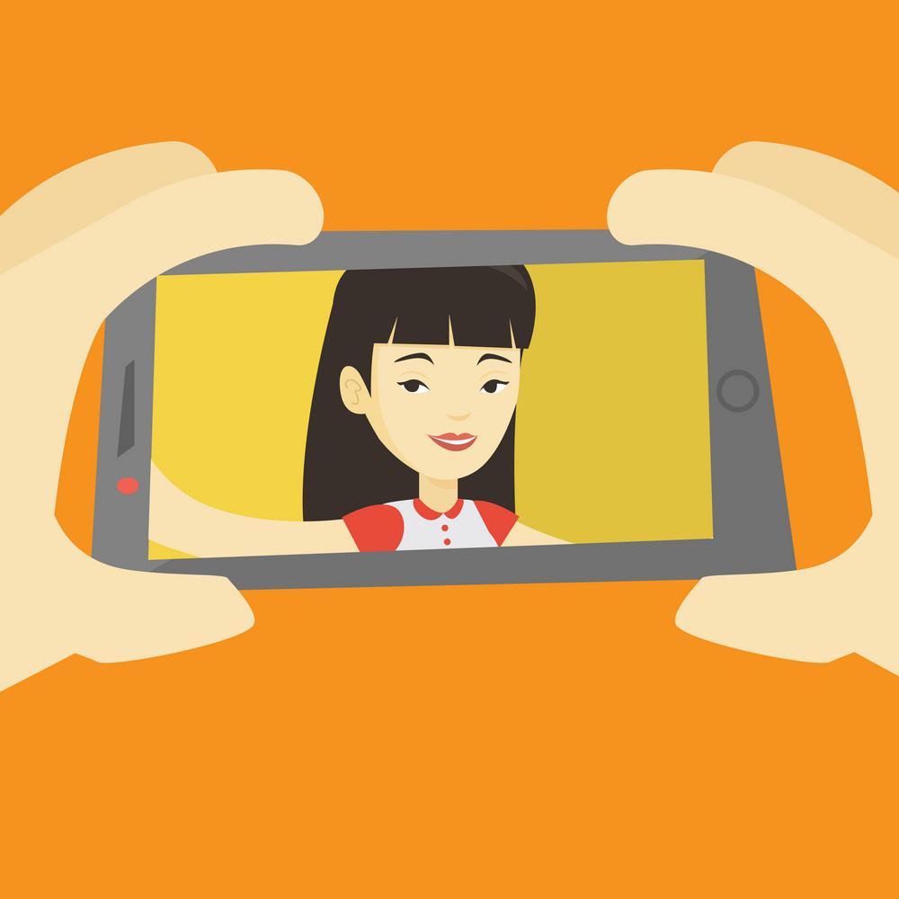 Young joyful asian woman making selfie. Smiling woman making selfie with cellphone. Woman taking selfie. Woman taking selfie using her smartphone. Vector flat design illustration. Square layout.