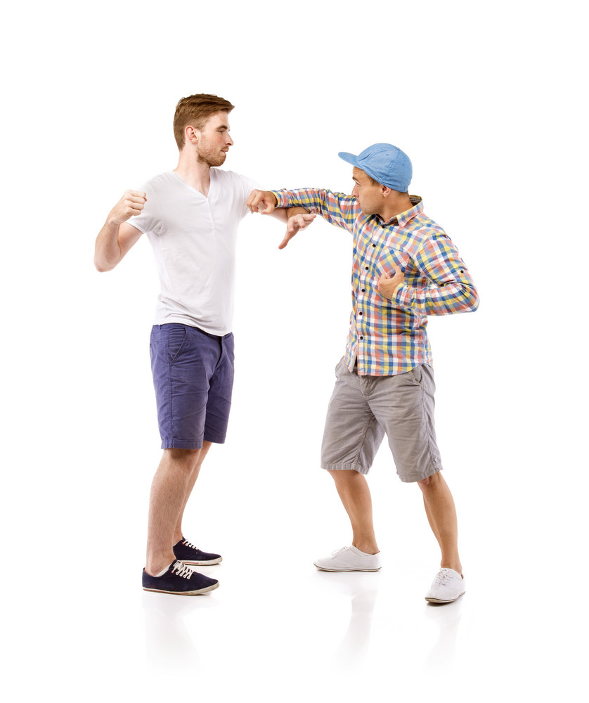 Young men fighting, isolated on white background