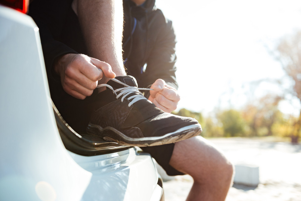 Young runner preparing in car. cropped image